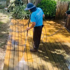 cleaning dirt off deck