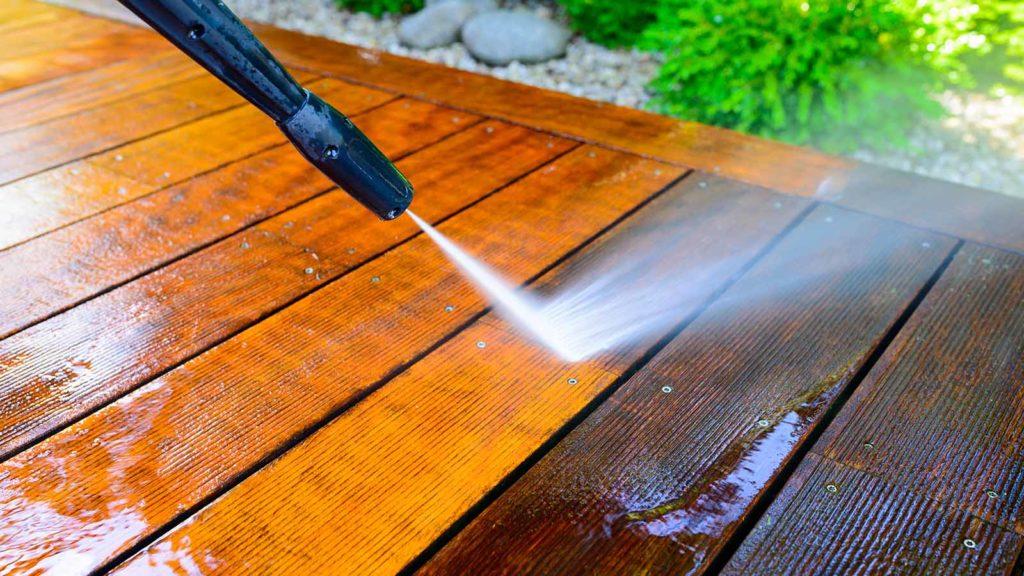 power spraying dirt off deck